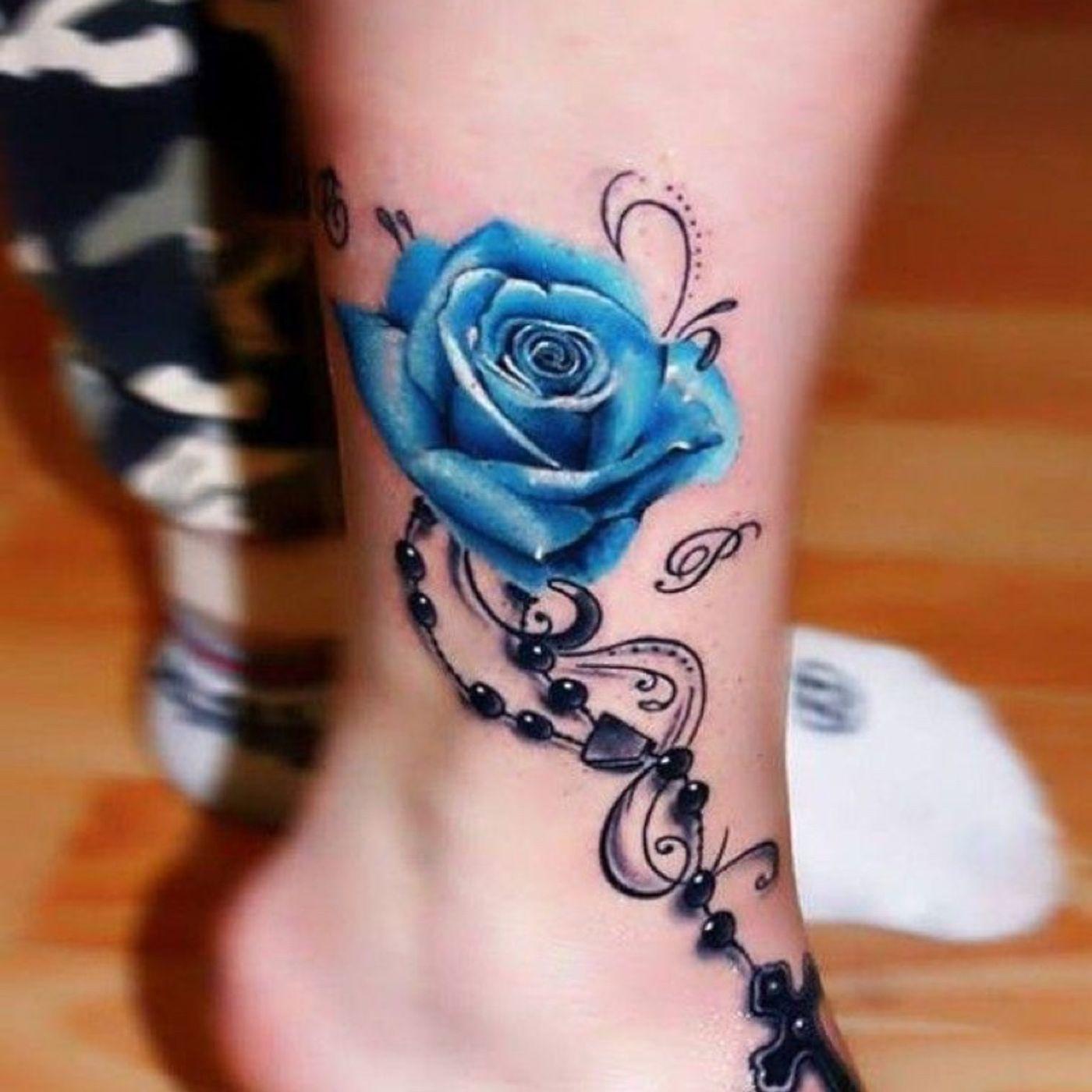 Означает тату роза на ноге