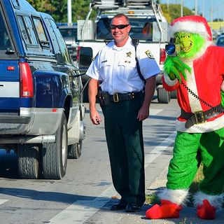Happy Holidays and the grinch lady cop