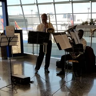 Boston Pops Brass Quintet Entertains Passengers At Logan Airport