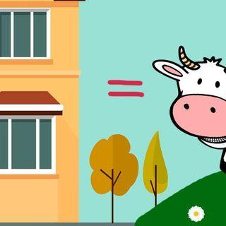 Una vaca y un edificio.