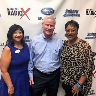 Joe Noonan with Southwestern Consulting, Pam Santoro with Berkshire Hathaway HomeServices Georgia Properties, and V. Lynn Hawkins with P3 Ac