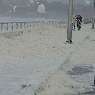 Sea Foam Rolls Over Nantasket Avenue In Hull