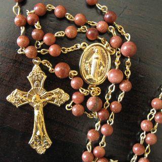 13 - Il Rosario. Teologia in ginocchio