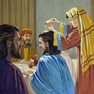 What is the significance of Jesus being anointed by a woman with an expensive perfume?