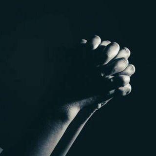 Praying in...
