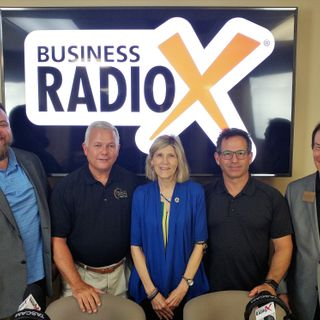 Ron Quinn and Susan Williams with Peach State Bank & Trust and Barry Zeeman with Barry's Menswear & Tuxedo