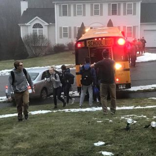 School Bus Full Of Students Slides Down Icy Road
