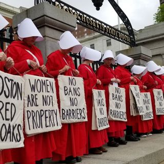Boston Red Cloaks Protest Abortion Restrictions At State House