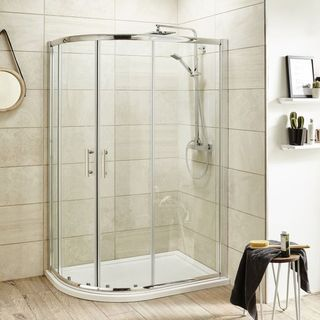 Offset quadrant shower enclosure with shower trays