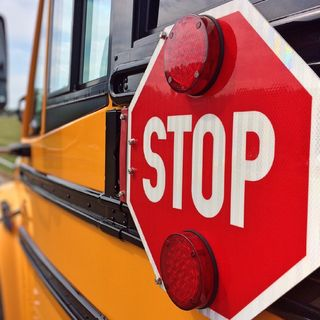 Should School Buses Be Able to Stop Both Lanes of Traffic?