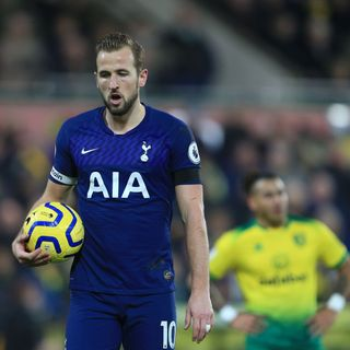 Kane rescues point for Spurs at Carrow Road