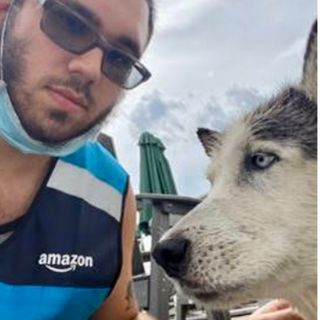The owners of a drowning dog in Woburn have an Amazon driver to thank for saving their pup's life