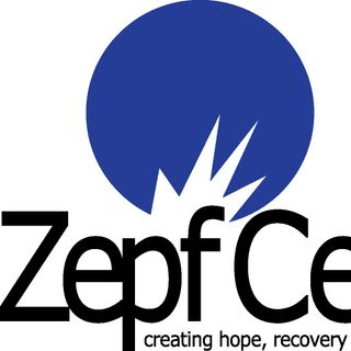 Fred talks with Deb Flores with the Zepf Center