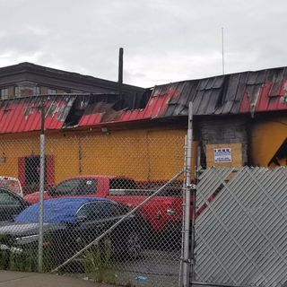 Fire Tears Through Roof Of Lawrence Car Lot Building