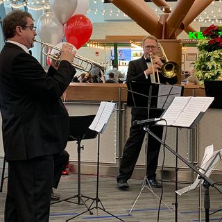 Boston Pops Brass Band Entertains Logan Airport Travelers