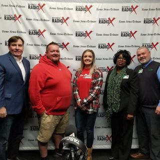 Dan Bevels of Floyd Medical Center, Patsy Wade of Heyman Hospice Care at Floyd, Hannah White of Fast Printing and Signs, and Eric McJunkin o