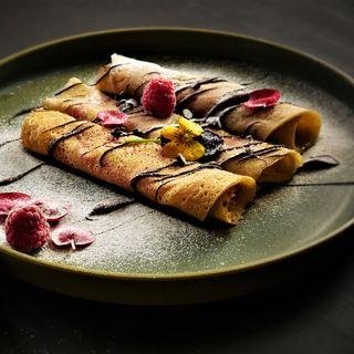Crêpes con lamponi e cioccolato