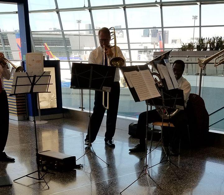 Boston Pops Brass Quintet Entertains Passengers At Logan Airport