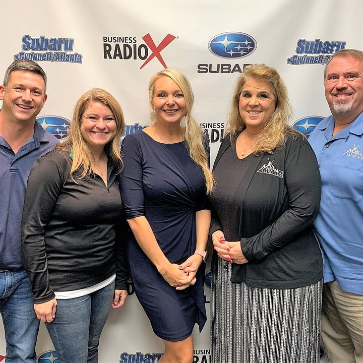 Natalie & Brian Thompson with Marco's Pizza and Leta Brooks with Status Home Design