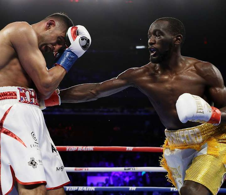 Inside Boxing Daily: What's next for Crawford? Did Khan quit? Danny Garcia impressive, another PPV joke, plus a look back at Lewis-Rahman 1